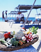 Fresh vegetables in a dish on a beach in St Tropez