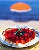 Strawberry and raspberry tart on the beach