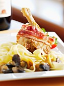 Stuffed duck leg with bacon and pasta ribbons