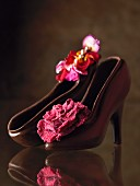 Chocolate shoes with a rose decoration