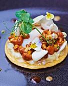 Chanterelle mushroom tart with pansy petals
