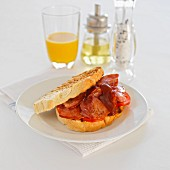 Toasted sandwich with bacon and tomatoes