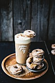 Squash doughnuts with spices, with a hot chocolate topped with cream