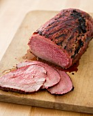 Smoked Roast Beef Sliced on a Wooden Cutting Board