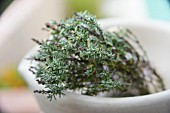 Sprigs of thyme in a bowl