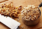 A Measuring Cup of Oats with Chopped Walnuts