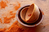 Small Wooden Bowls with Spilled Paprika