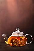 Tea flowers in a glass teapot