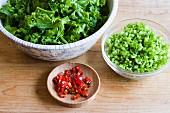 Bowl of chopped mustard greens, chopped stems & chilli