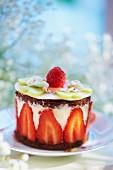 Individual chocolate layer cake with yoghurt and strawberries