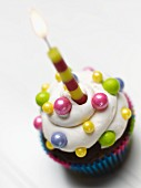 A Decorated Cupcake with a Candle