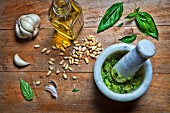 Pesto being made in a Mortar and Pestle