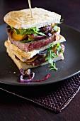Beef steak, onion and ricotta sandwich