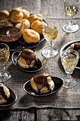 Profiteroles with tea-vanilla cream and chocolate glaze