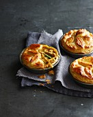 Still life of three chicken pies made with puff pastry