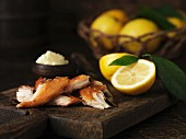 Pieces of mackerel with lemons and butter