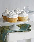 Banana meringue tarts on cake stand