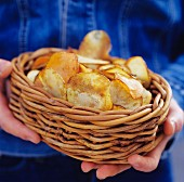 Hands holding a basket of potato chips