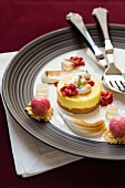 Lemon meringe tartlets with strawberry sorbet