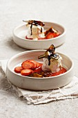 Baked goat's cheese with white chocolate, strawberry sauce and aubergine
