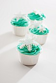 Cupcakes decorated with green icing and snowflakes