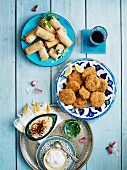 Spring rolls and vegetable cakes with dips