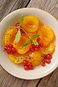Apricot soup with redcurrants