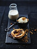 Pasteis de nata with ganache and almond brittle, vanilla ice cream and chai tea