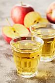 Apple juice and fresh apples