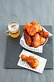 Fried chicken pieces with a glass of beer