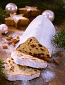 Butter stollen (German fruit cake), partly sliced