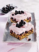Two servings of blackcurrant cream cake