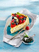 A slice of lime cheesecake with berries and mint pesto