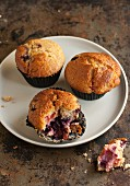 Blueberry and apricot muffins, one partly eaten