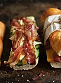 A baguette filled with bacon, blue cheese and cucumber