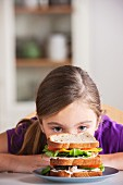 Girl staring at sandwich