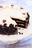 Chocolate Layer Cake with Cream Cheese Icing and Chocolate Hearts; Slice Removed