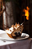 A Slice of S'more Pie on a White Plate; Fireplace
