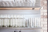 Empty Bottles and Glasses on Shelves