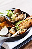 Clams in White Wine Broth with Radish and Garlic Bread Toast Points