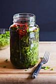 Homemade Pickled Mustard Greens in a Mason jar