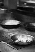 Skillets on a Commercial Oven; Black and White