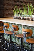 Stools at a Bar; Row of Bulbs on Bar