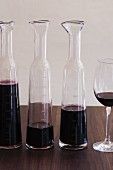 Red Wine in Decanters and a Glass