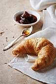 A croissant and fig jam
