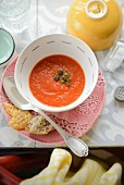Tomato soup with fried capers and parmesan crisps