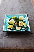 Spinach salad with potato dumplings
