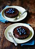 Individual chocolate tarts with fresh blueberries