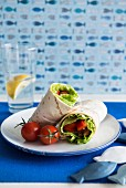 Wraps with fish and tomatoes