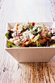 Cobb Salad in a White Square Bowl; Chicken, Bacon, Blue Cheese and Avocado
